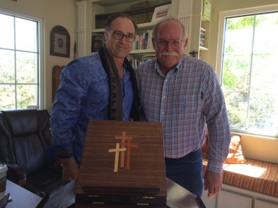 Larry Ciesla presenting Rev. Dr. William Lewis                   the Jeffersonian Bookstand